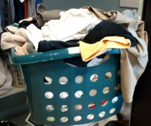 This Laundry Basket contains 18 pounds of various clothes (shirts, t-shirts, cut-offs, towels, sheets and pillow cases for queen size bed. Shown as an example only. Your laundry might weigh slightly less or more.
